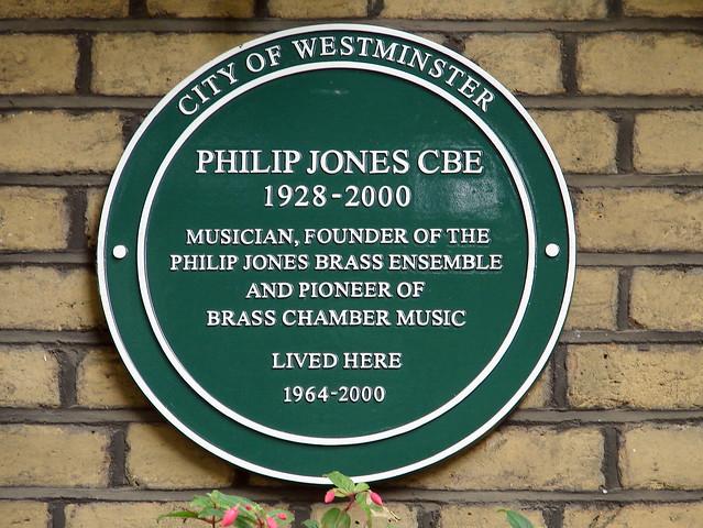 Philip Jones green plaque - Philip Jones CBE  1928 - 2000  Musician, founder of the  Philip Jones brass ensemble  and pioneer of  brass chamber music  lived here  1964 - 2000