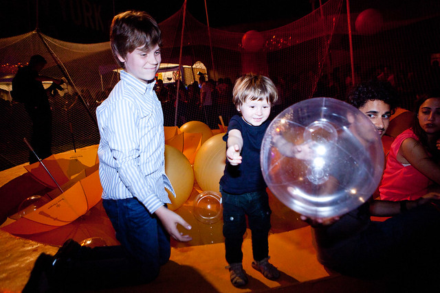 Kids playing with the Veuve Cliquot balls in the pool