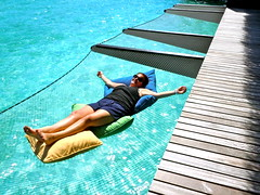 surfing--equipment and supplies(0.0), hammock(0.0), surfboard(0.0), sitting(0.0), swimming pool(1.0), leisure(1.0), photo shoot(1.0), physical fitness(1.0),