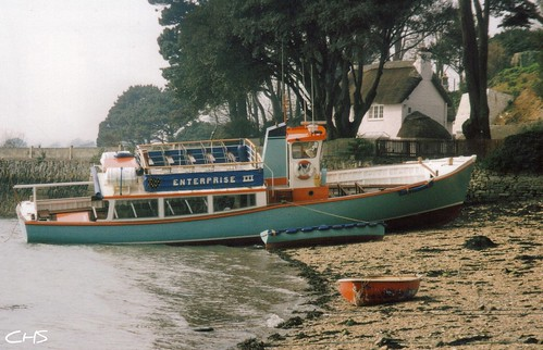 An unusual photo of Enterprise III beached at Flushing, Penryn River - 1996 by Stocker Images