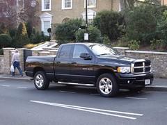 automobile(1.0), automotive exterior(1.0), pickup truck(1.0), dodge ram rumble bee(1.0), dodge ram srt-10(1.0), wheel(1.0), vehicle(1.0), truck(1.0), rim(1.0), ram(1.0), bumper(1.0), land vehicle(1.0),