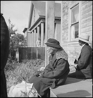Centerville, California. Grandmother of farm family awaits evacuation bus. Evacuees of Japanese an . . ., 05/09/1942