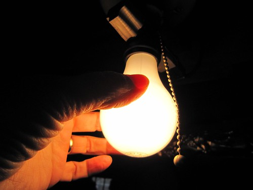 Photograph showing a hand holding a lightbulb