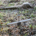 Front of a leaning wooden cross
