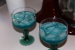 cobalt blue(0.0), aqua(1.0), distilled beverage(1.0), liqueur(1.0), glass(1.0), green(1.0), blue hawaii(1.0), drink(1.0), cocktail(1.0), blue(1.0), alcoholic beverage(1.0),