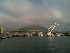 Departing Cape Town for Robben Island (site of jail for political prisoners, Nelson Mandela)