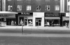 Historic photo from Saturday, September 3, 1983 - Capitol Theatre and buildings to the north - 2498 Yonge St. - Penelope Hope, Soraya Sewing Supplies in North Toronto