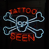 tattoo seen neon sign form