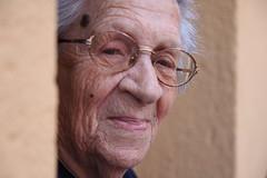 hand(0.0), man(0.0), nose(1.0), glasses(1.0), face(1.0), skin(1.0), senior citizen(1.0), head(1.0), close-up(1.0), wrinkle(1.0), elder(1.0), person(1.0), portrait(1.0), adult(1.0), eye(1.0),