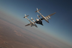 VMS EVE carries VSS Enterprise on her first manned flight, seen soaring over Mojave. Photo by Mark Greenberg
