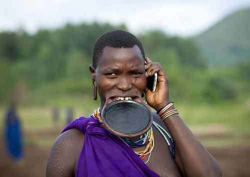 The beginning of the end? Surma woman with mobile phone - Ethiopia