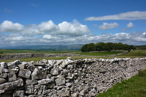 Limestone dry stone walling and blue skies