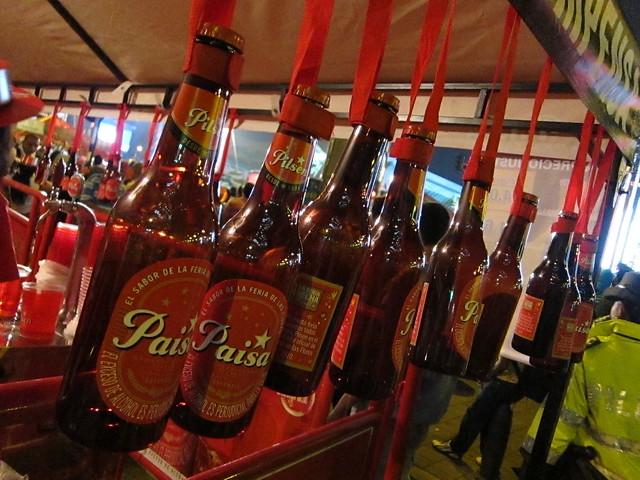 Plastic Pilsen bottles dangle, awaiting their fill of the local beer.
