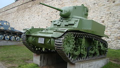 armored car(0.0), combat vehicle(1.0), weapon(1.0), vehicle(1.0), tank(1.0), self-propelled artillery(1.0), gun turret(1.0), churchill tank(1.0), land vehicle(1.0), military(1.0),