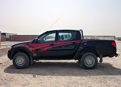 compact sport utility vehicle(0.0), ford ranger(0.0), automobile(1.0), automotive exterior(1.0), pickup truck(1.0), vehicle(1.0), truck(1.0), bumper(1.0), nissan navara(1.0), mitsubishi triton(1.0), land vehicle(1.0),