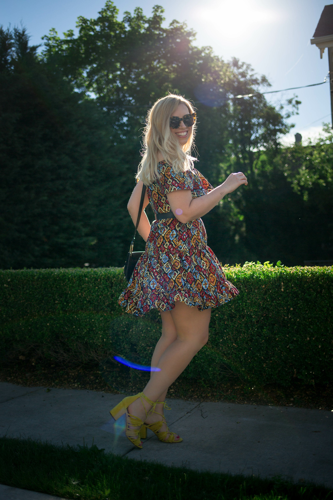 Why Printed Dresses are Better than Solids | Colorful Dress Twirling Pose Hastings on Hudson New York