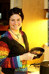 rachel serving herself dinner