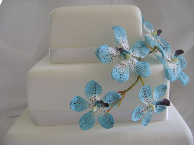 wedding cake with blue orchids