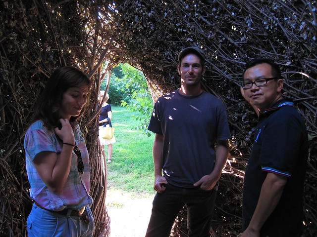 Andy Lynch (center), assistant to Patrick Dougherty, with Emily Dinan (left), BBG's compost project coordinator, and Johnathan Chan (right), a BBG volunteer inside Natural History at BBG.