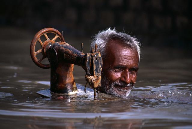 Tailor in Monsoon, Porbandar, Gujarat, India, 1983, by Steve McCurry