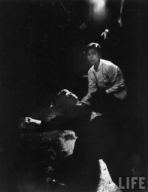 Busboy Juan Romero aiding Robert Kennedy as he lies semiconscious in his own blood on the floor of the Ambassador Hotel Kitchen after being shot in brain and neck, by Bill Eppridge 1968