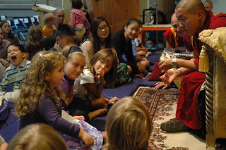 Dilgo Khyentse Yangsi Rinpoche answers a young person's question, monk and author Matthieu Ricard listening, Children's and Young People's Audience and Blessing, First Nations Longhouse, UBC, Vancouver BC, Lotus Speech Canada