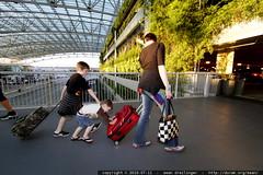 nick pushing sequoia pushing rachel's red suitcase