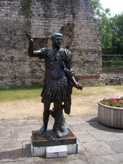 Londinium: Statue of Trajan in front of a section of the Roman wall, Tower Hill