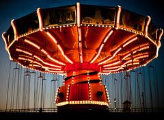 recreation(0.0), outdoor recreation(0.0), musical theatre(0.0), ferris wheel(0.0), park(0.0), tourist attraction(1.0), carousel(1.0), night(1.0), amusement ride(1.0), amusement park(1.0),