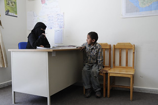 A case worker interviews a new arrival at a shelter for street children. | by World Bank Photo Collection