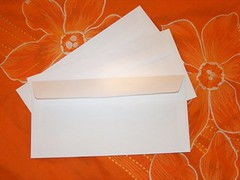 white envelopes on orange
