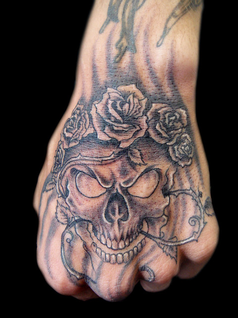 Skull and roses tattoo (note: i don't usually do hands tattoo this is a tattoo artist)