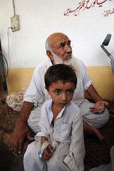 Morsalin and his grandson found shelter from the floods in a school in Charsadda, Pakistan
