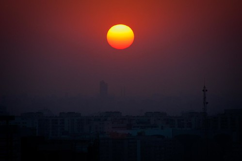 africa city sunset red sky orange sun egypt cairo pollution