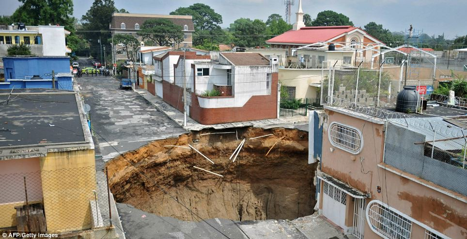 Aftermath:  sink hole in Guatemala City