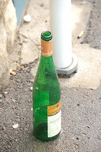 Empty bottle on the sidewalk