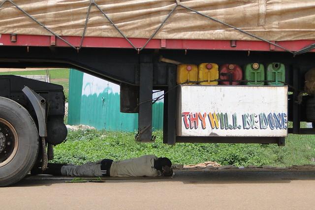 Thy Will Be Done - Man Sleeps under Semi-Trailer - Bolgatanga - Ghana