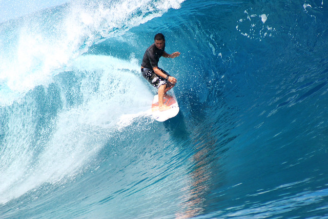 Smooth wave riding at Teahupoo, Tahiti.