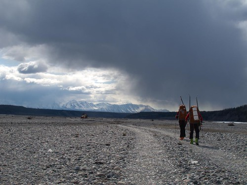 Dylan Taylor and Danny Uhlmann walking down the Nizina River floodplain near the Nizina bridge on a 100-mile ski/hike from Skolai Pass to McCarthy, Wrangell Mountains, Alaska.