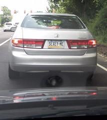 automobile(1.0), automotive exterior(1.0), vehicle(1.0), mid-size car(1.0), honda(1.0), compact car(1.0), bumper(1.0), land vehicle(1.0), honda accord(1.0),