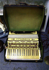 accordion(0.0), personal computer hardware(0.0), diatonic button accordion(0.0), folk instrument(0.0), button accordion(0.0), player piano(0.0), electronic instrument(0.0), wind instrument(0.0), musical instrument(1.0),