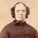 Older victorian woman with unusual head gear