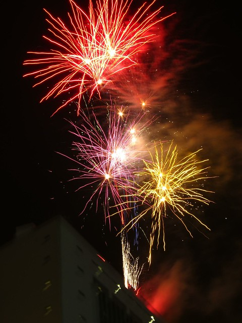 Fireworks explode over a government building.