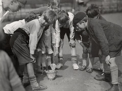School children, tiddler catching, London 1928, by E.O. Hoppe