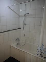 Bath tub in bathroom