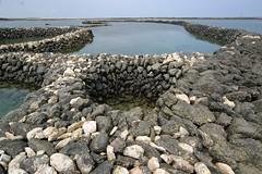 澎湖七美石滬展現傳統捕魚技術,兼顧生態與生產,也是里山倡議的精神。(攝影:林文鎮)