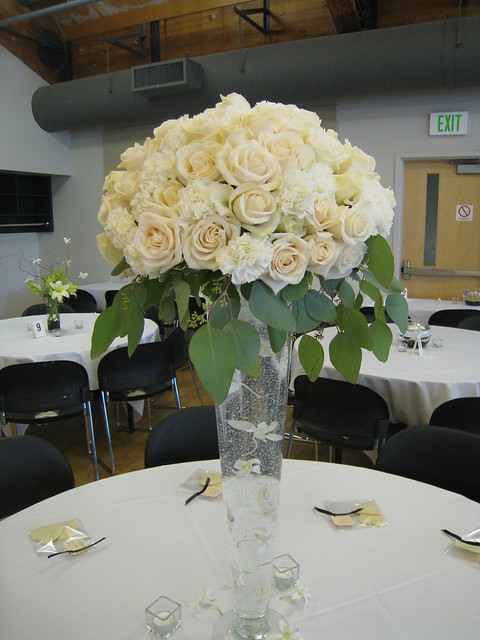 Tall rose centerpiece 28 glass vase with a large dome of white carnations
