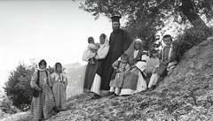 Family and their priest, Zemeno, Corinth, by Fréderic Boissonnas 1903