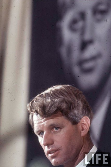 Robert Kennedy on the campaign trail, his older brother looming above, by Bill Eppridge