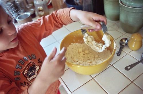 Child making dessert in the kitchen.